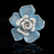 Diamond and Blue Topaz 18k White Gold Flower Ring