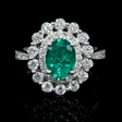 1.23ct Diamond and Emerald 18k White Gold Ring