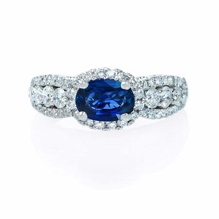 Diamond and Oval Blue Sapphire 18k White Gold Halo Ring