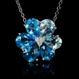.09ct Diamond and Blue Topaz 18k White Gold Pendant
