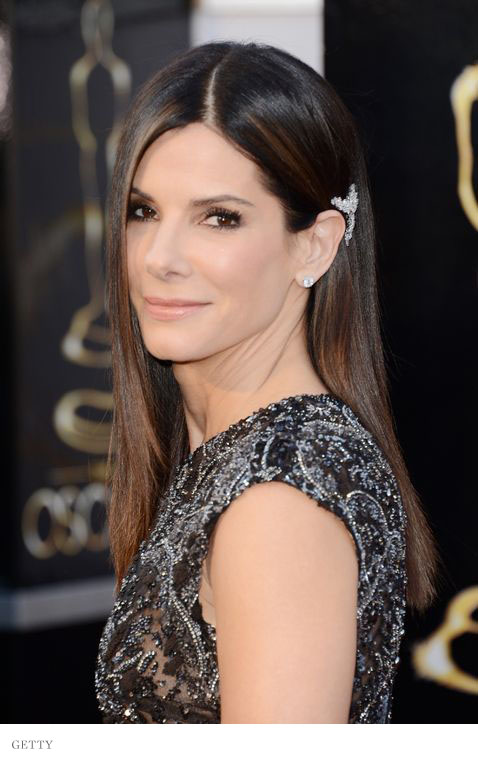 Sandra Bullock accented her sparkling sheer black Elie Saab Couture